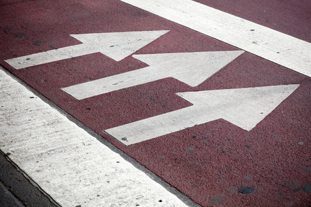Pedestrian crossing with road marking  white arrows and rectangles on the dark asphalt road photo