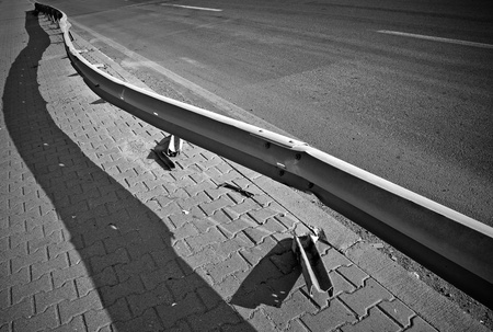 Damaged barrier on the highway  Black and whit photo photo
