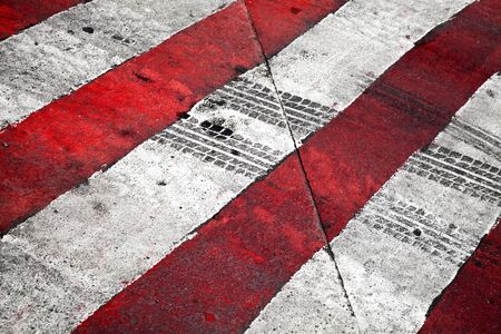 Road background with crossing of red white road marking and tires track Stock Photo - 15658679