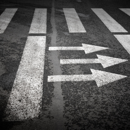 Pedestrian crossing with road marking  white arrows and rectangles on the dark asphalt road Stock Photo - 15652461