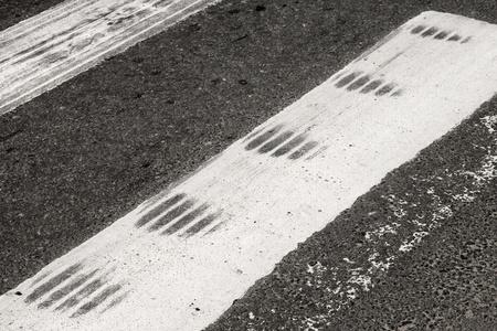 braking: ABS Emergency braking tracks on the pedestrian crossing