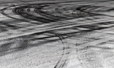 cars race: Abstract road background with crossing of tires tracks Stock Photo