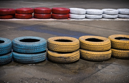 sportster: Fragment of a barrier on a carting track made of an old painted tires Stock Photo