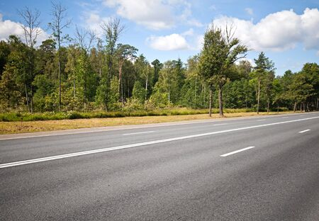 Asphalt highway in the summer Stock Photo - 15658680