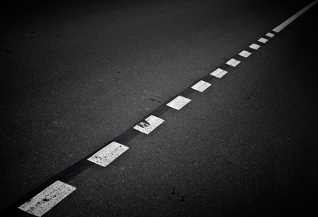marking up: Dark asphalt road background with marking lines  Close up photo Stock Photo