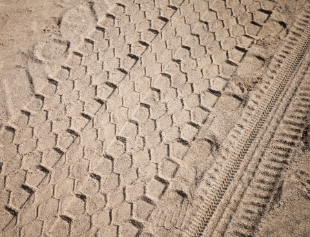 Abstract traffic background  Closeup view on tires tracks on the rural road Stock Photo - 15658695