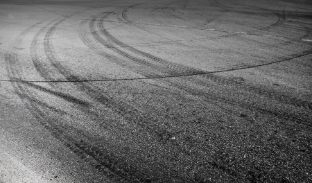Abstract turning road background with tires track photo