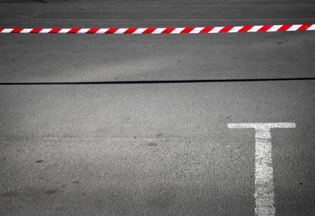 barrier free: Abstract minimal background with empty parking place and prohibiting red and white striped tape Stock Photo