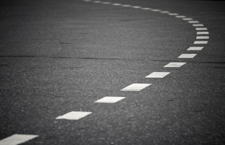 Turning asphalt road with marking lines  Close up photo Stock Photo - 15652463