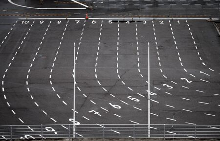 Ferry terminal asphalt area with marking lines and numbering photo
