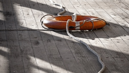 naval: Lifebuoy with rope on the naval deck