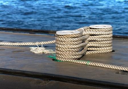 bonding rope: Modern military submarine fragment careful bundle of rope on the mooring bollard Stock Photo