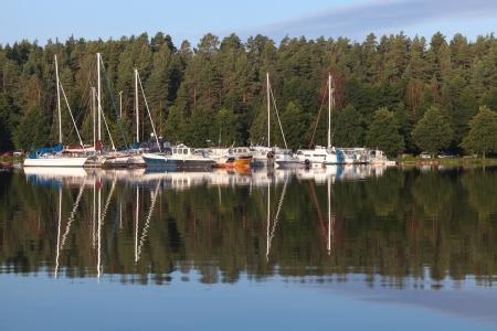 small boat: Yachts and pleasure boats moored in small European marina  Imatra town, Saimaa lake, Finland Stock Photo