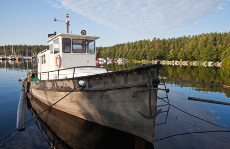 Fishing boat moored in the Imatra harbor, Finland photo