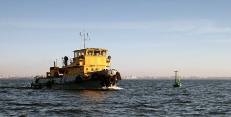 superstructure: Small Tugboat with yellow superstructure in Gulf of Finland