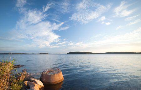 Concrete mooring bollard with ships chain on the coast of Saimaa lake in Finland photo