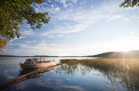 moored: Small fishing boat moored on Saimaa lake in Imatra town, Finland Stock Photo