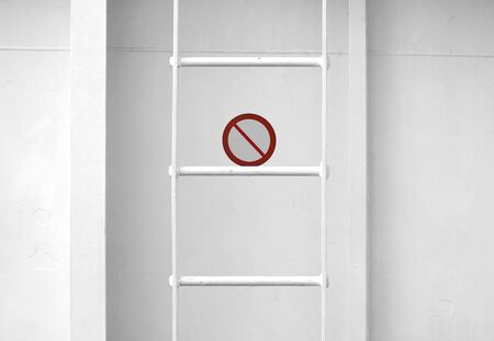 backstairs: White metal naval ladder closeup detailed texture with prohibitory sign