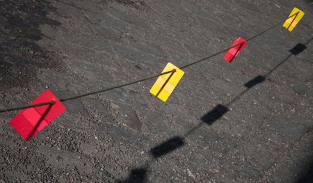 margin of safety: Bright red and yellow labels on the prohibited line