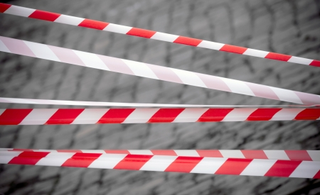 margin of safety: Red and white striped tapes  Restricted area border