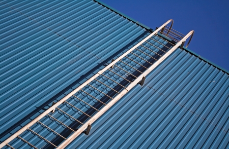 backstairs: metal ladder on blue metal wall