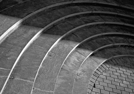 Six curved footsteps made of stone with shadow walking across it Stock Photo - 15722283