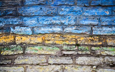 Old stone wall texture with colorful stripes Stock Photo - 15841180