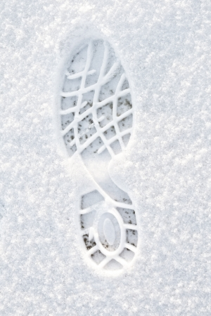 Footstep on the fresh friable snow photo