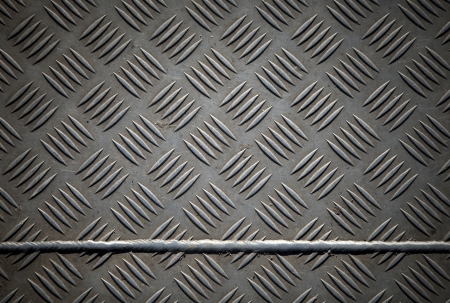 Closeup texture of diamond metal plate with joint photo