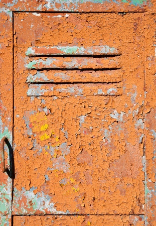 Old metal door texture with bright cracked painting photo