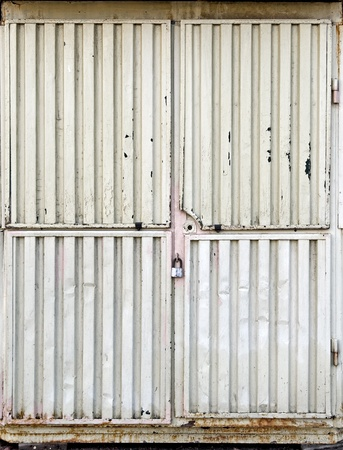 Locked gate of an small metal kiosk Stock Photo - 15742084