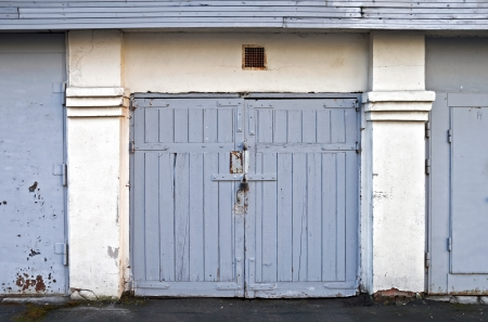 Old locked wooden garage door in Saint-Petersburg, Russia photo
