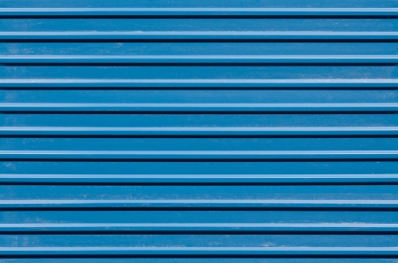 Horizontal ridged blue painted metal wall texture photo