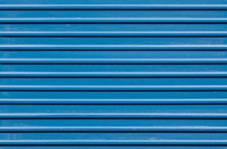 ridged: Horizontal ridged blue painted metal wall texture Stock Photo