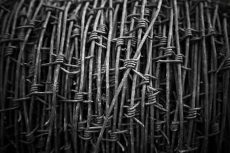 barblock: Dark barbed wire bundle background