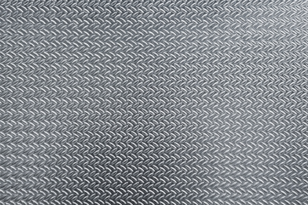 Closeup texture of gray metal plate with details photo