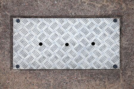 Closeup texture of diamond metal panel with holes photo