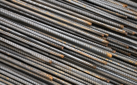 Background texture of steel rods used in construction to reinforce concrete photo