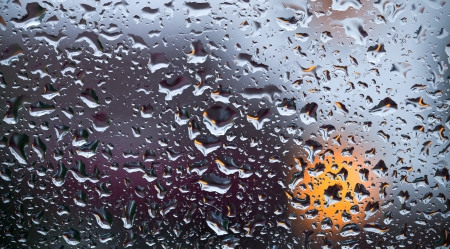 Beautiful abstract colorful background with water drops over window glass photo