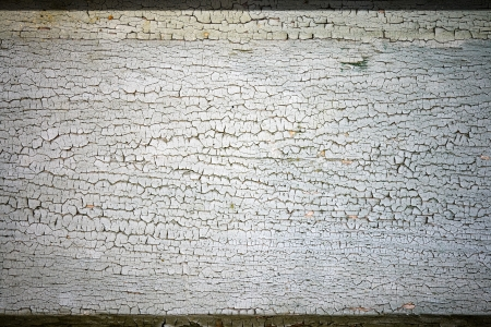 Background texture of an old wooden surface with cracked paint photo