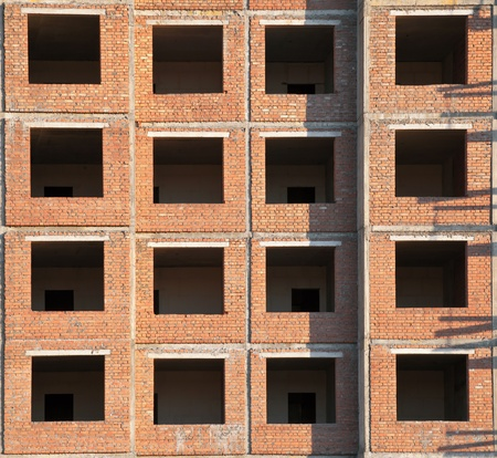 Brick wall with windows of modern living house under construction Stock Photo - 15841005