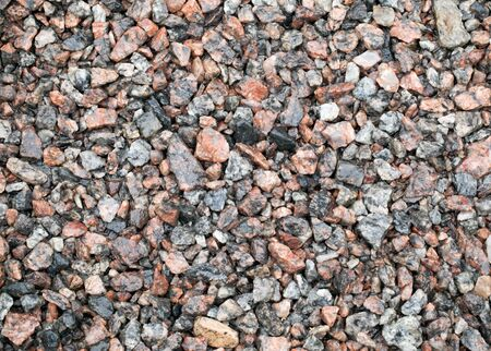 riverbed: Detailed background texture of wet gravel ground after the rain