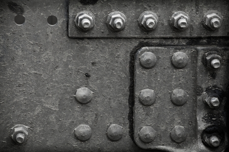 steel head: Industrial abstract background texture with black steel structure with bolts and rivets Stock Photo