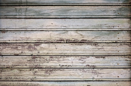 Detailed background texture of old painted wall made of wooden lining boards photo