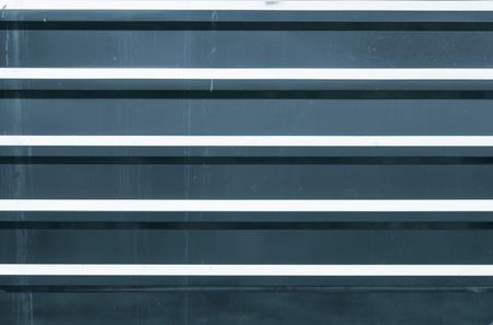 Horizontal ridged blue metal wall background texture Stock Photo - 15840103