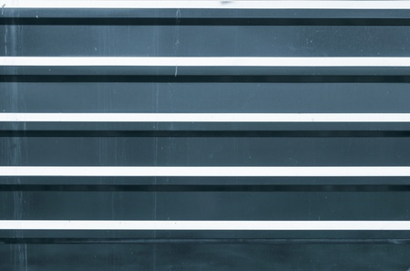 ridged: Horizontal ridged blue metal wall background texture