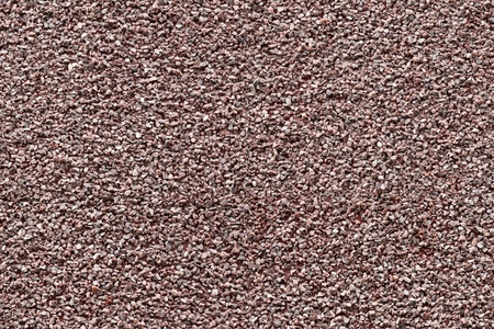 Seamless background texture of red granite chips panel photo