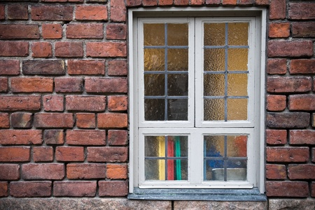 Background texture of old red brick wall with window photo