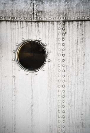 sidelight: Porthole on the white metal naval wall