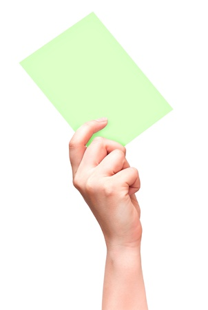 Female hand with empty light green card isolated on white photo